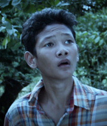 Khoun Darith, playing LUCKY in the Cambodian supernatural historical drama, FREEDOM DEAL: Story of Lucky
