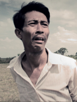 Sok Polynn, playing the Travelling Wedding Musician in the Cambodian supernatural drama, FREEDOM DEAL: Story of Lucky